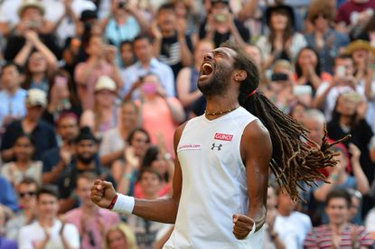 Germany's Dustin Brown celebrates beating Spain's Rafael Nadal during their men's singles second round match on day four of the 2015 Wimbledon Championships.