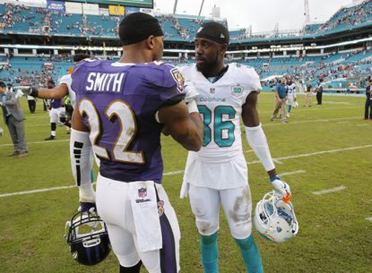 Ravens cornerback Jimmy Smith (22) greets Miami Dolphins defensive back Tony Lippett (36) during the second half.