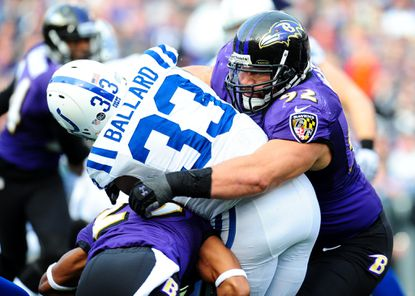 Haloti Ngata wraps up Colts running back Vick Ballard in the first quarter of the AFC wild-card game.