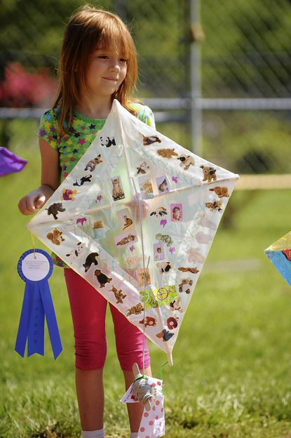 Heidi Middleton, of Arbutus, holds her kite, decorated with animal pictures and stickers that won her the award for most creative during the first kite flying ompetition at the Charlestown retirement community last year.