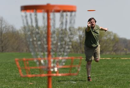 of Sparks works on refining his disc golf skills, making use of an empty field in Cockeysville on Wednesday, April 7, 2021.