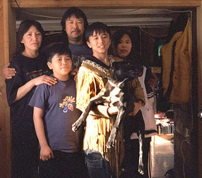Both worlds: Gayle and Steven Tritt and their three children, Peter, 9; Adrien, 12; and Fiona, 11, split their time between tiny Arctic Village and urban areas where Steven Tritt works in construction.