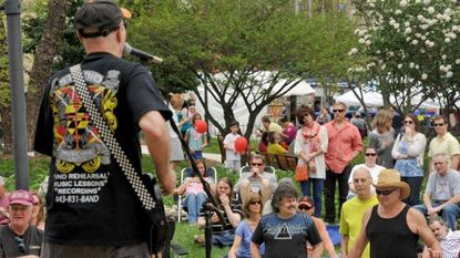 Rob Fahey (back to camera), is shown performing during the 2014 Towsontown Spring Festival. Fahey, of Ravyns and Rob Fahey & The Pieces fame, is scheduled to play at Full Moon Pub on Friday at 8:30 p.m.