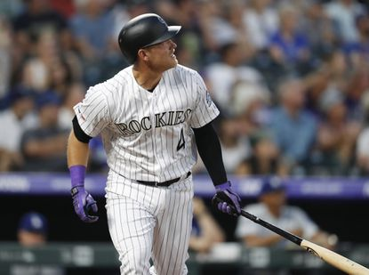 Colorado Rockies pinch-hitter Pat Valaika follows the flight of his two-run home run off Los Angeles Dodgers starting pitcher Hyun-Jin Ryu in the fifth inning of a baseball game Friday, June 28, 2019, in Denver.