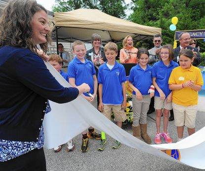 Jamie Kaplan, the founder the Legacy School, was joined by students from the school in Sykesville for a special banner-cutting ceremony May 28 to officially open the school's new building.