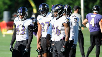 Ravens players Jaylen Hill, Sheldon Price and Chuck Clark at practice this weekend.