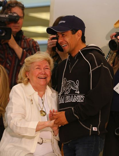 California Chrome jockey Victor Espinoza speaks to Patrice Wolfson, owner of the last Triple Crown winner Affirmed, during Wednesday's Belmont Stakes draw.