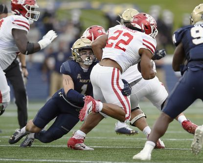 John Marshall, tackling Houston running back Kyle Porter in October 2020, moved from safety to the outside linebacker position known as striker out of necessity. The Gonzaga College graduate steadily improved as the season progressed and developed into one of Navy's best defenders.