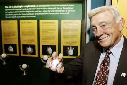 In this March 29, 2007, file photo, Baseball Hall of Famer Phil Niekro holds a knuckleball at the Great Lakes Science Center in Cleveland. Niekro, who pitched well into his 40s with a knuckleball that baffled big league hitters for more than two decades, mostly with the Atlanta Braves, has died after a long fight with cancer, the team announced Sunday, Dec. 27, 2020. He was 81. (AP Photo/Tony Dejak, File)
