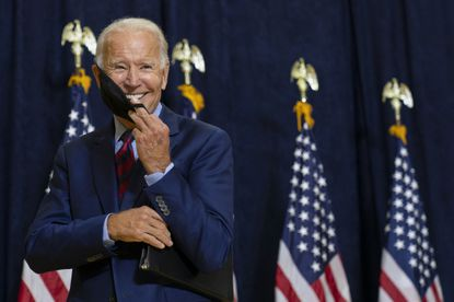 Joe Biden smiles as he puts on his face mask after speaking to media in Wilmington, Del., on Sept. 4, 2020. (AP Photo/Carolyn Kaster)