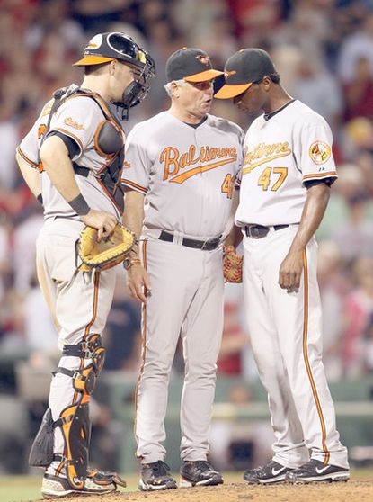 Orioles pitching coach Rick Adair, center, talks with catcher Matt Wieters and reliever Pedro Viola after Viola allowed the last of three consecutive Red Sox home runs in the seventh inning.