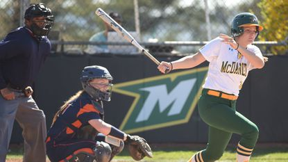 McDaniel's Megan Horsey connects with an RBI base hit against Gettysburg during a Centennial Conference softball game at McDaniel College on April 16, 2019.