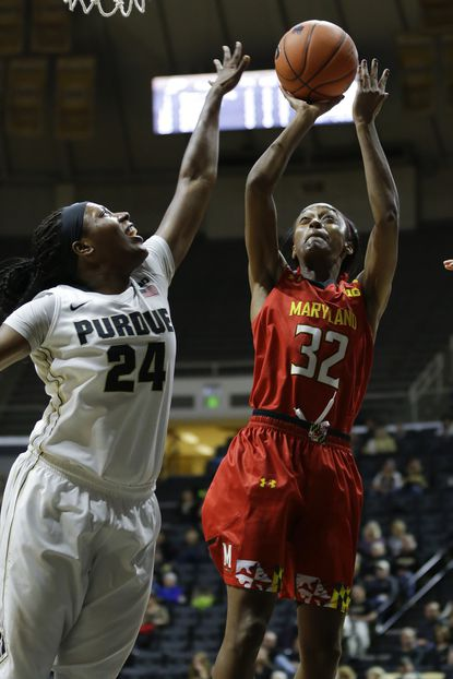 Maryland guard Shatori Walker-Kimbrough (32) shoots over Purdue guard Andreona Keys (24) during the first half of an NCAA basketball game in West Lafayette, Ind., Tuesday, Feb. 2, 2016.