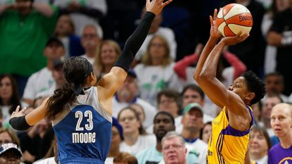 Alana Beard lines up her game-winning shot against the Lynx during Game 1 of the WNBA Finals on Oct. 9.