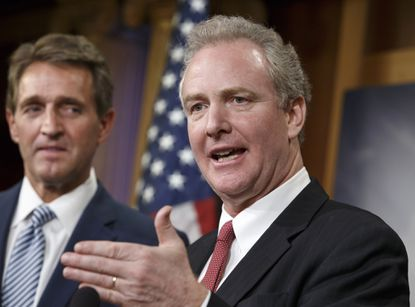 Rep. Chris Van Hollen, D-Md., speaks as Sen. Jeff Flake, R-Ariz. listens during a news conference on Capitol Hill in Washington.