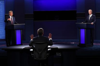 """President Donald Trump, left, again accused Democratic presidential nominee Joe Biden, right, of wanting to """"defund the police"""" during Tuesday night's debate at Case Western Reserve University in Cleveland."""