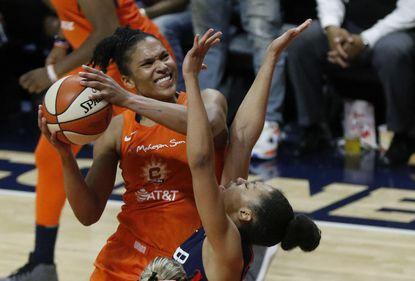 Connecticut Sun forward Alyssa Thomas (Maryland) shoots over Washington Mystics' Aerial Powers during the second half in the Sun's Game 4 victory. The teams play a decisive Game 5 in Washington on Thursday.