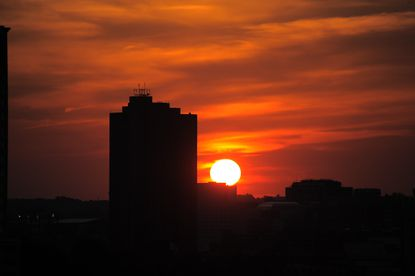 The sun sets over Baltimore as seen from the Domino Sugars plant in Locust Point.