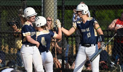Severna Park celebrates a second-inning run in a 3-1 win over Chesapeake at the Bachman Sports Complex on May 8 that gave the Falcons the Anne Arundel County championship.