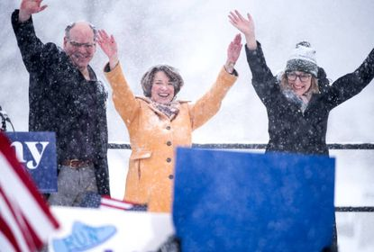 John Bessler is a University of Baltimore law professor, author, ardent death penalty opponent, writing coach, dad, and informal advisor — and husband — of Minnesota senator and Democratic presidential candidate Amy Klobuchar. In this Feb. 10, 2019, photo, Klobuchar is joined by Bessler, left, and daughter Abigail Bessler, right, after announcing her 2020 presidential bid in heavy snow in Minneapolis.