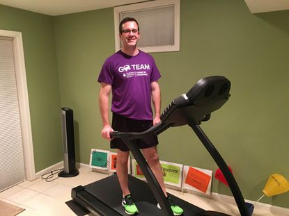 Jonathan Wilson, executive director of the Maryland chapter of the Leukemia & Lymphoma Society, stands on the treadmill in the basement of his home in Columbia. Wilson will attempt the run for 24 hours on a treadmill at Charm City Run in Timonium to raise money and awareness for the treatment and prevention of blood cancers.