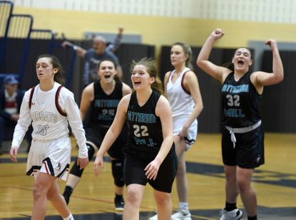 Patterson Mill's Beatrice Orsini, front, and her teammates begin to celebrate their 63-62 overtime win against Bel AIr Wednesday evening.