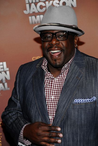 Comedian and actor Cedric The Entertainer arrives at the opening night of the Michael Jackson The Immortal World Tour in Los Angeles Jan. 27. He will be performing at 7 p.m. Saturday in Baltimore as part of a Memorial Day weekend comedy series.