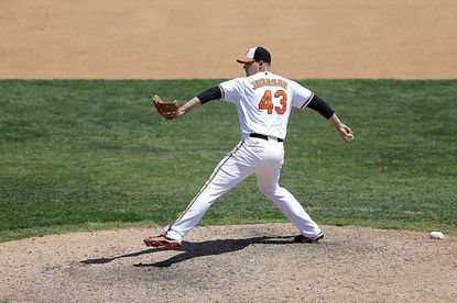 Baltimore Orioles relief pitcher Jim Johnson throws during the ninth inning of an exhibition spring training baseball game against the New York Mets, Saturday, March 30, 2013, in Sarasota, Fla. (AP Photo/Carlos Osorio)