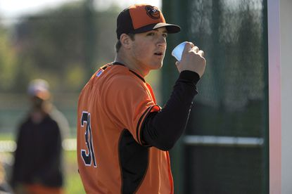 Orioles right-hander Kevin Gausman looks on during workouts at the Orioles' spring training facility last month.