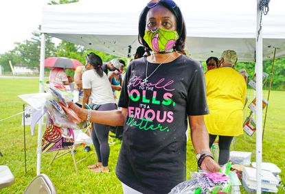 Linda Gilmore shops, purchasing several Afro-centric face coverings to support Black-owned and small businesses, at the Hosanna School Museum's fourth annual Juneteenth Celebration on June 20 at the museum in Darlington.