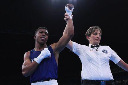 Maryland boxer Gary Antuanne Russell wins 1st Olympic bout for family