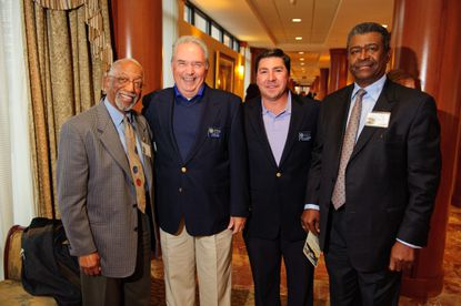Craig Day, second from left, poses for a photo during Turf Valley Resort's 50th anniversary party. Standing with Morgan State's Chuck Thomas (left), Turf Valley Director of Golf Nick Spinnato (second from right) and Morgan State's Ivory Tucker, Day celebrated his 50-year anniversary at the golf club in early March.