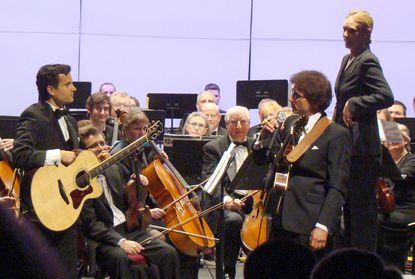 Anna Binneweg, at podium, with guitarists Vinny Raniolo, left and Frank Vignola, right.