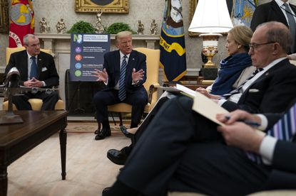President Donald Trump speaks during a meeting about the coronavirus response with Gov. Phil Murphy, D-N.J., in the Oval Office of the White House, Thursday, April 30, 2020, in Washington. From left, Murphy, Trump, White House coronavirus response coordinator Dr. Deborah Birx, and White House chief economic adviser Larry Kudlow. (AP Photo/Evan Vucci)