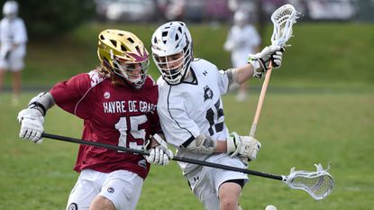 Havre de Grace defender Braeden Bushyager collides with Patterson Mill's Kevin Dyke as he tries to make a move while bringing the ball up the field in Wednesday afternoon's game at Patterson Mill.