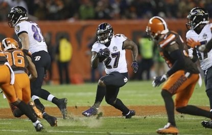 Ravens running back Terrance West (27) runs the ball against the Cleveland Browns in the second half.