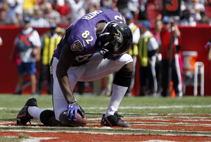 Ravens wide receiver Torrey Smith reacts after scoring a touchdown against the Tampa Bay Buccaneers during the first quarter at Raymond James Stadium.