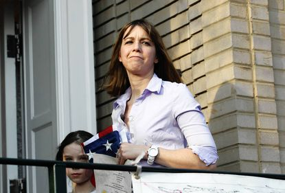 Patti Blagojevich, with daughter Annie, looks out at the crowd of well wishers after her husband former Governor Rod Blagojevich spoke to reporters and supporters gathered outside their house.