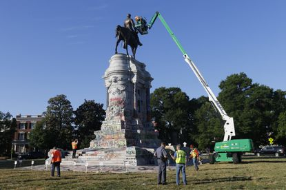 An inspection crew from the Virginia Department of General Services inspect the statue of Confederate Gen. Robert E. Lee on Monument Avenue Monday June. 8, in Richmond, Va. Virginia Gov. Ralph Northam has ordered the removal of the statue.