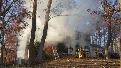 Firefighters battle a blaze in the 5500 block of High Tor Hill in Columbia.