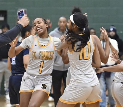 St. Frances' Aniya Gourdine, left, and Angel Reese celebrate after defeating St. Vincent Pallotti by score of 55 to 51 to win IAAM girls basketball A-Conference Championship game at Stevenson College. Photo by: Kenneth K. Lam 2/16/20