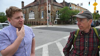Jacob Wittenberg of Edgemont Builders, left, and Ted Rouse stand at the corner of East Lanvale Street and Guilford Avenue, where they are developing several properties.