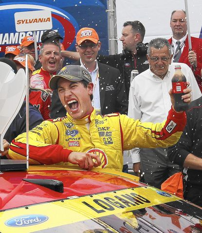 Joey Logano celebrates in Victory Lane after winning the NASCAR Sprint Cup series auto race at New Hampshire Motor Speedway in Loudon, N.H., Sunday, Sept. 21, 2014. (AP Photo/Cheryl Senter) ** Usable by LA, DC, CGT and CCT Only **