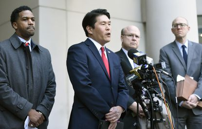 U.S. Attorney Robert Hur, second from left, speaks to reporters after former Baltimore Mayor Catherine Pugh's sentencing hearing at U.S. District Court in Baltimore. Pugh was sentenced to three years in federal prison for arranging fraudulent sales of her self-published children's books to nonprofits and foundations to promote her political career.