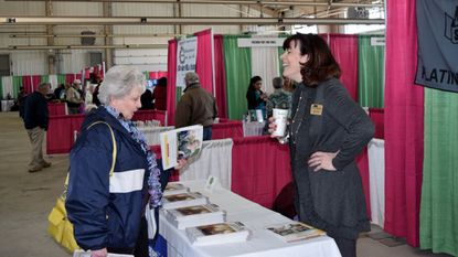 Barbara Snyder, right, with The Retirement Living Sourcebook, discusses housing options with Wilma Brown, of Taneytown, at the Seniors on the Go Expo at the Carroll County Agriculture Center in Westminster on April 6, 2016. This year's expo is set for Wednesday, April 4.