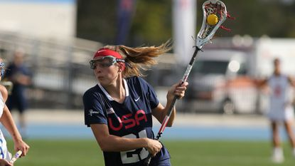 Maryland alumna Taylor Cummings, a two-time Baltimore Sun Athlete of the Year at McDonogh, is one of seven Team USA players from Baltimore-area high schools. Here she advances the ball during a 2017 exhibition.