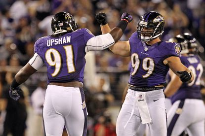 Ravens linebackers Courtney Upshaw and Paul Kruger celebrate a sack in the win against the Bengals.