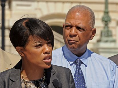 Baltimore, MD-6/24/15- Baltimore City Schools CEO Gregory Thornton stands behind Mayor Stephanie Rawlings Blake during a press conference outside City Hall announcing that the Youth Works city-business partnership has 8,000 summer jobs for Baltimore City youth. Amy Davis/ Baltimore Sun - #2404