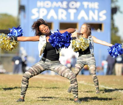 Laurel High Poms team members junior Briana Culbertson (left) and senior Iahyanna Johnson (right) perform together during halftime at Laurel High's homecoming football game Saturday, Oct. 13.