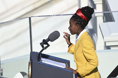"""American poet Amanda Gorman reads her poem """"The Hill We Climb"""" during the 59th Presidential Inauguration at the U.S. Capitol in Washington, Wednesday, Jan. 20, 2021. (Saul Loeb/Pool Photo via AP)"""